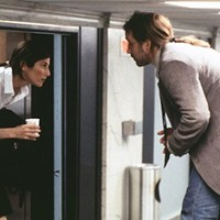 SHE STOOPS TO CONQUER: Maxine (Catherine Keener) toys with Craig (John Cusack) in Being John Malkovich (Photo: Criterion)