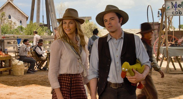 SHOOTING BLANKS: Seth MacFarlane (pictured with Charlize Theron) elected to (mis)cast himself in A Million Ways to Die in the West. (Photo: Universal)