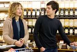 LOREY SEBASTIAN / WARNER BROS. - SHOP TALK Sarah (Meg Ryan) and Carter (Adam Brody) discuss what's in store for them in In the Land of Women