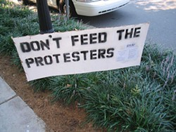 KAREN SHUGART - Signs outside Gateway Village urged people to ignore protesters