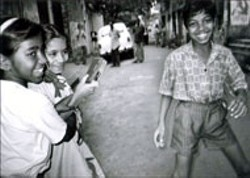 WWW.KIDS-WITH-CAMERAS.ORG - SMILE FOR THE CAMERA A moment of happiness - for some of the children featured in Born Into - Brothels, part of the Factory Films series at Spirit - Square