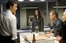UNIVERSAL - SPY VS. SPY: Ray (Clive Owen, left) and Claire (Julia Roberts, center) each try to maintain the upper hand in Duplicity.