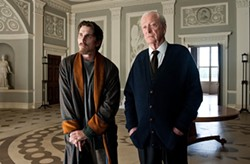 WARNER BROS. - STATELY WAYNE MANNER: Faithful manservant Alfred (Michael Caine, right) tends to the reclusive Bruce Wayne (Christian Bale) in The Dark Knight Rises.