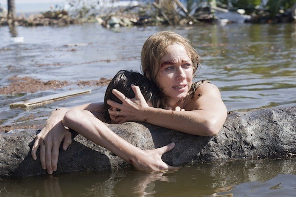 STAYING ALIVE: Maria (Naomi Watts) comforts her son Lucas (Tom Holland) in The Impossible. (Photo: Summit Entertainment)