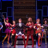 Steven Booth as Charlie Price (center) in Kinky Boots