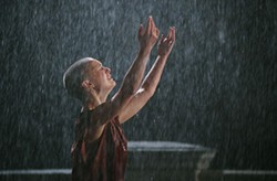 DAVID APPLEBY / WARNER - STINGIN' IN THE RAIN Evey (Natalie Portman) washes away her tears in V For Vendetta.