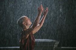 DAVID APPLEBY / WARNER - STINGIN' IN THE RAIN Evey (Natalie Portman) washes away her tears in V For Vendetta.
