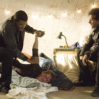 STRONG ARM OF THE LAW: Alex Cross (Tyler Perry) and Tommy Kane (Edward Burns) interrogate a suspect in Alex Cross. (Photo: Summit Entertainment)