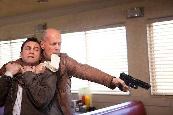 STRUGGLING WITH HIMSELF: Old Joe (Bruce Willis) gets a grip on his younger self (Joseph Gordon-Levitt) in Looper. (Photo: Sony)