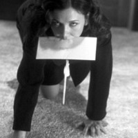 TAKE A LETTER Maggie Gyllenhaal puts in overtime      at the office in Secretary
