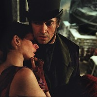 TAKING CARE: Jean Valjean (Hugh Jackman) tends to a deathly ill Fantine (Anne Hathaway). (Photo: Universal)