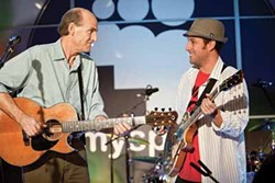 UNIVERSAL - TAYLOR MADE: George Simmons (Adam Sandler, right) jams with James Taylor (as himself) in Funny People.