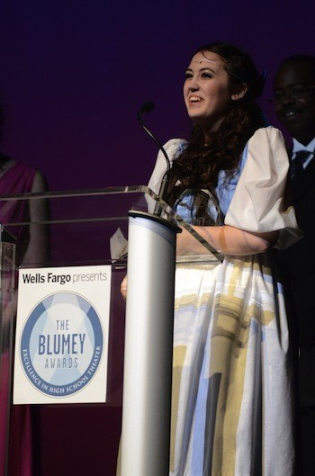 Taylor Neal accepts her Blumey Award for Best Actress