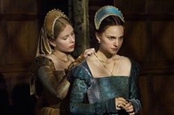 ALEX BAILEY / COLUMBIA & FOCUS - THE AFFAIR OF THE NECKLACE: Mary (Scarlett Johansson, left) helps Anne (Natalie Portman) prepare for her date with destiny in The Other Boleyn Girl.