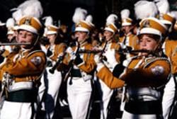 The Carrousel Parade marches through center city on - Thursday