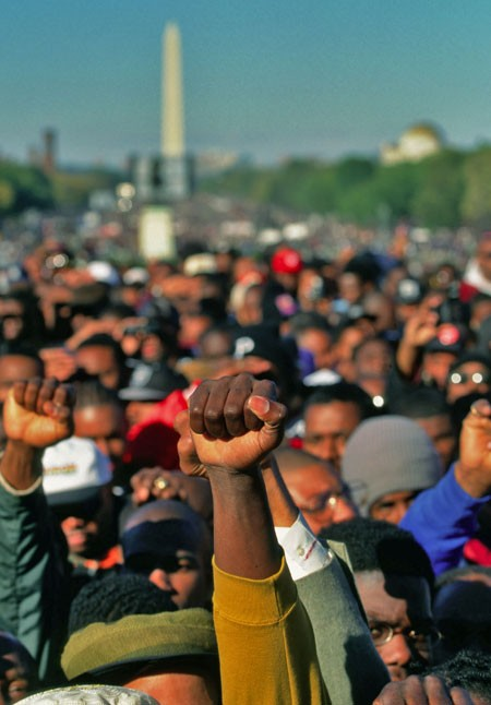 The crowd reacts to Minister Louis Farrakhan's speechs at the Million Man March on October 17, 1995. - DENNIS BRACK/NEWSCOM
