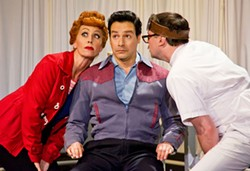 JUSTINBARBIN.COM - THE EYES HAVE IT: Lucy (Sirena Irwin) and Ricky (Bill Mendieta) pay a visit to the eye doctor (Karl Hamilton) in I Love Lucy Live on Stage.