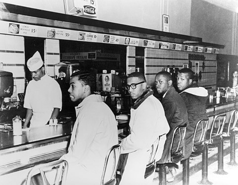 The Greensboro Four sit in at Woolworth's lunch counter. F. McCain is second from left