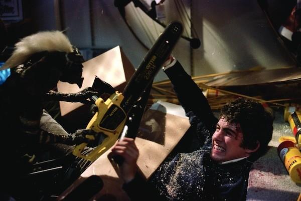 THE GREMLIN CHAIN SAW MASSACRE: Billy (Zach Galligan) protects himself in Gremlins. (Photo courtesy Warner Bros.)
