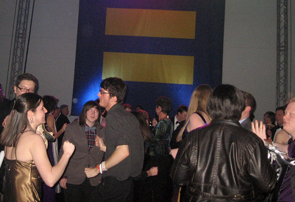 The HRC revelers dance to a DJs set of retro hits