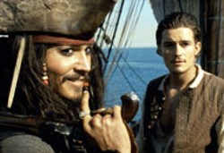 ELLIOT MARKS/DISNEY & JERRY BRUCKHEIMER, INC - THE SHIPPING NEWS Johnny Depp and Orlando - Bloom gather info before a perilous journey in - Pirates of the Caribbean