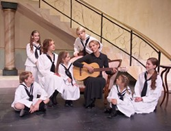 TOM COVINGTON - The Sound of Music's Maria and the von Trapp kids: Back row - Emily Calder, Robert Blanton; seated - Padgett Vaughn, Julia Kelly, Susan Knowlson; front row - Ben Bridges, Caroline Kasay, Emily Johnson