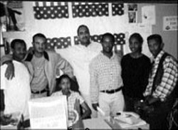 The staff of the Eritrean newspaper Keste - Debena in happier times. Editor Milkias Mihretab, - center, fled to the United States through Sudan and - Ethiopia when the crackdown came. The journalists - on each side of him, Medhanie Haile (left) and - Temesgen Gebreyesus, are among those imprisoned.