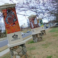 These ceramic and stone kiosks on the far west edge of Wesley Heights (designed by artist Cheryl Foster) welcome residents and visitors to the city's west side