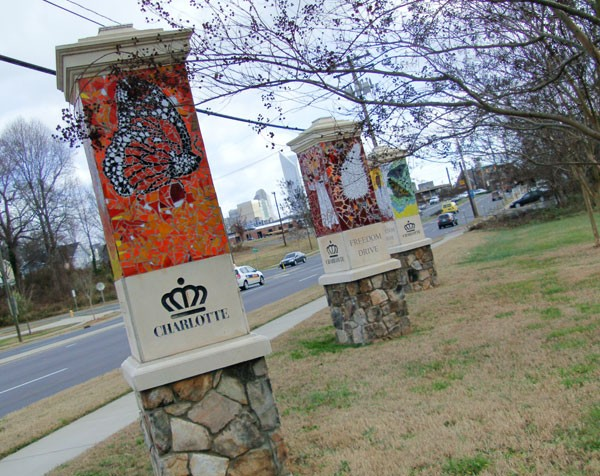 These ceramic and stone kiosks on the far west edge of Wesley Heights (designed by artist Cheryl Foster) welcome residents and visitors to the citys west side