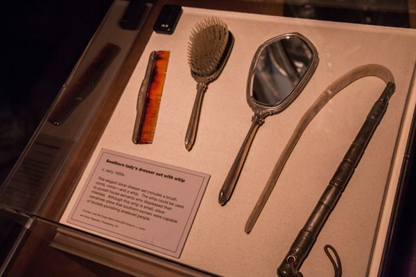 This elegant silver dresser set includes a brush, comb, mirror - and a whip. The whip could be used to punish house servants who displeased their mistress. - JOE MARTIN