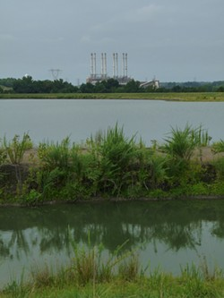 RHIANNON FIONN - This is one of the two unlined, high-hazard coal-ash ponds behind Duke Energy's Riverbend plant. It's 80-feet deep, encompasses 41 acres and can fit 200 tennis courts on its surface. Charlotte-Mecklenburg Utilities withdraws 80 percent of the city's drinking water just downstream.