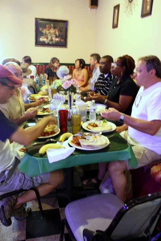 Tour participants get to know one another while enjoying heaping platefuls of Chicken Suqaa