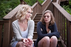 JODY LE / FOX SEARCHLIGHT - TWISTED SISTER: Lucy (Sarah Paulsen, left) tries to understand her troubled sibling (Elizabeth Olsen) in Martha Marcy May Marlene.