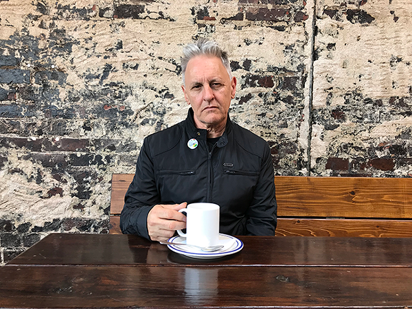 Mickey Stephens, immigrant, has coffee at a local Irish pub. (Photo by Mark Kemp)