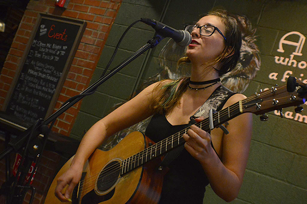 Lisa De Novo performs at her open mic night. (Photo by Jimmy Ski Photography)