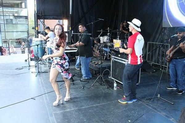 Furia Tropikal perform at a street festival.