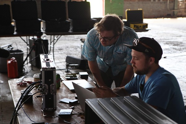 Button and Tyndall (seated) check out the footage from Down Yonder at Camp North End. (Photo by Alex Cason)