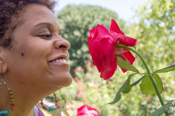 Stacey Rose stops to smell the… well, you know. (Photo by Jonathan Cooper)