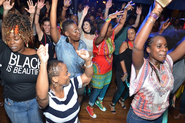 AfroPop partiers raise their hands in the air during the September event at Morehead. (Photo Courtesy of AfroPop! Nation)