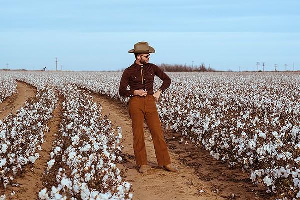 Mr. Crockett surveys the cotton.