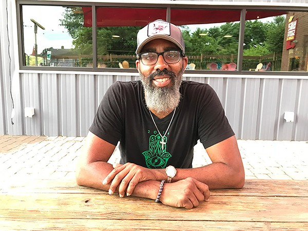 That Guy Smitty chills on the patio at Birdsong Brewing, just before a hard rain began to fall. (Photo by Mark Kemp)