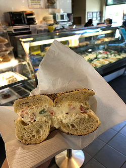 An everything bagel with veggie cream cheese (Photo by Sophie Whisnant)