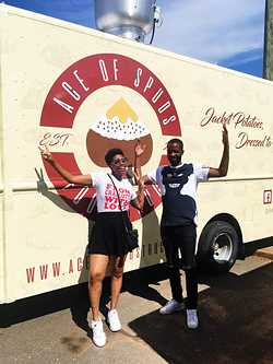 Saloan Rochelle (left) and Rel Dunlap pose with the truck.