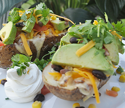 Southwest potato skin stuffed with homefried style potatoes with black beans, corn, cheese and avocado.