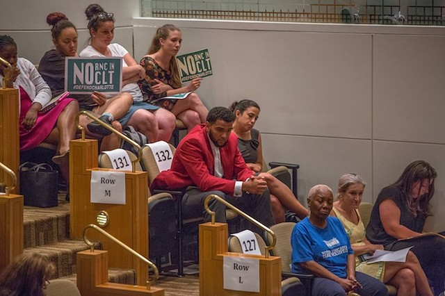 The last speakers look on at Monday's meeting. (Photo by Grant Baldwin)