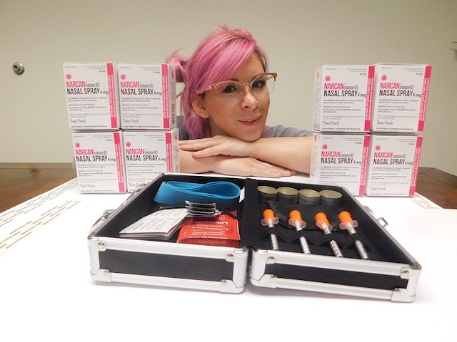 Cat Nelson with some supplies at Queen City Needle Exchange (Photo by Dana Vindigni)