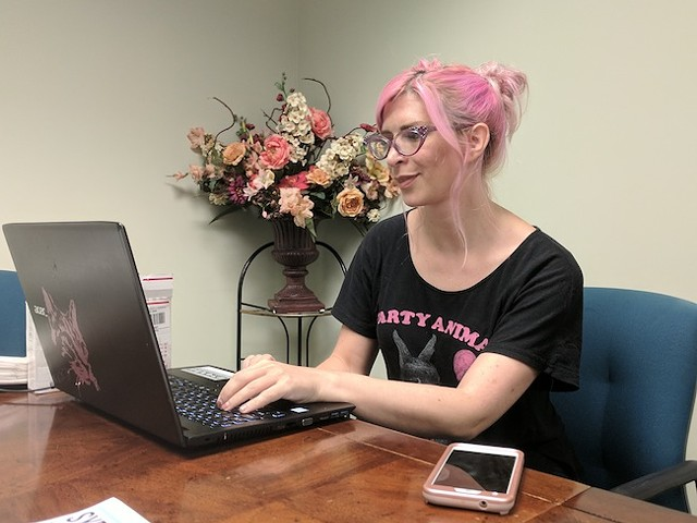 Cat Nelson at the Carolinas CARE Partnership offices where she runs the exchange.(Photo by Ryan Pitkin)