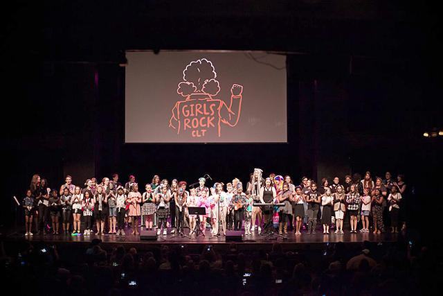 The entire camp stands on stage for the 2017 Girls Rock CLT concert (Photo by Dani Nicole Photography)