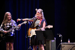 Two girls perform on their instruments for the 2017 showcase concert. (Photo by Dani Nicole Photography)