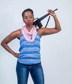 Tracie Frank posing with an automatic rifle prop (Courtesy of Brand New Sheriff Productions)